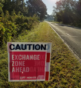 Sign that says Caution, exchange zone ahead