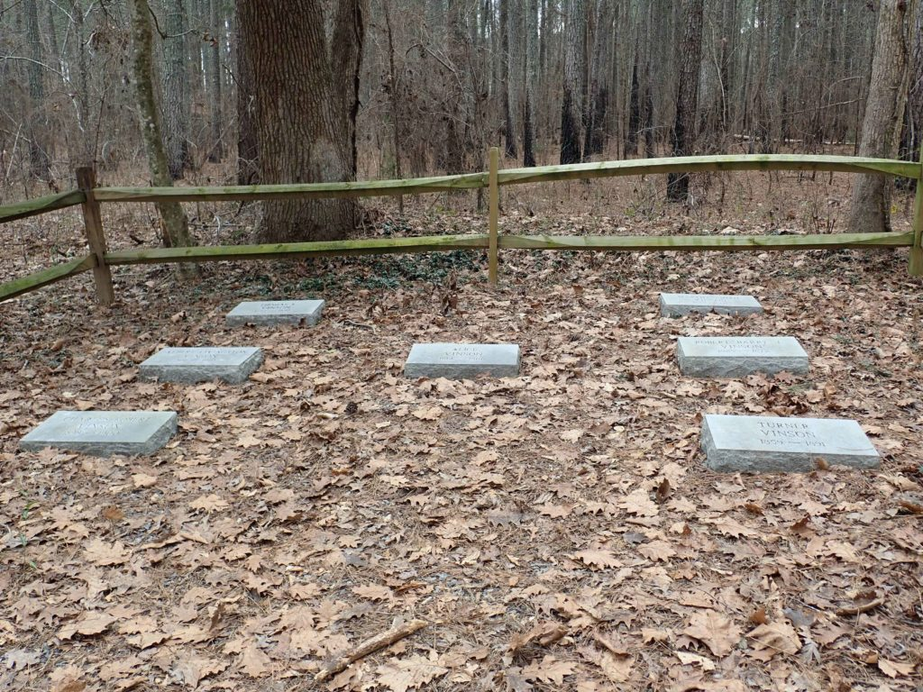 seven flat gravestones at top of Summit Loop