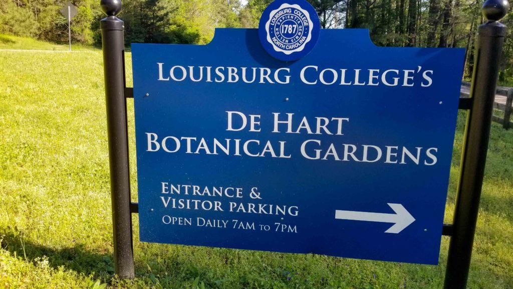 Blue Entrance sign for De Hart Botanical Gardens