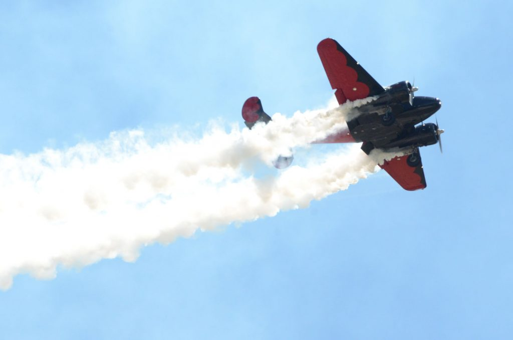 Wings over wayne red propeller plane