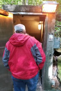 man standing in front of entrance to Mammoth Cave