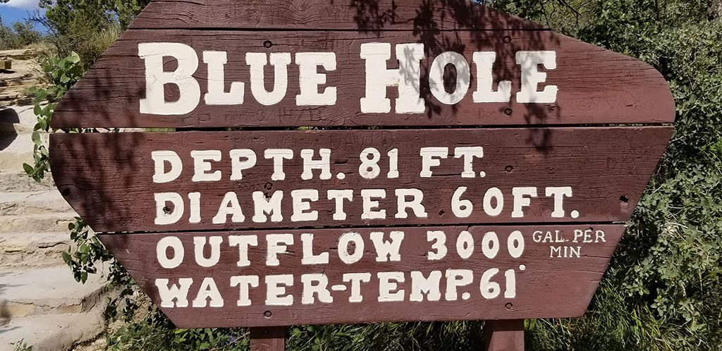 Santa Rosa Blue Hole sign indicating 81ft depth and diameter of 60 feet
