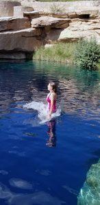 Woman jumping into Santa Rosa Blue Hole