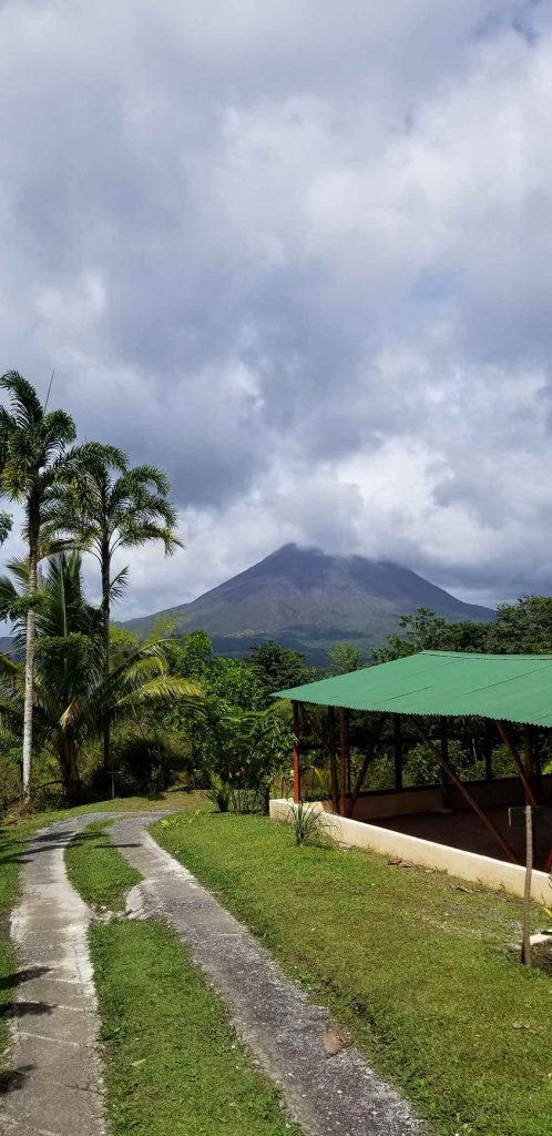 Yoga studio with Arenal Volcano peeking through clouds in background