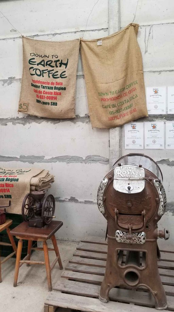 Canvas bags hanging on wall at Down to Earth coffee