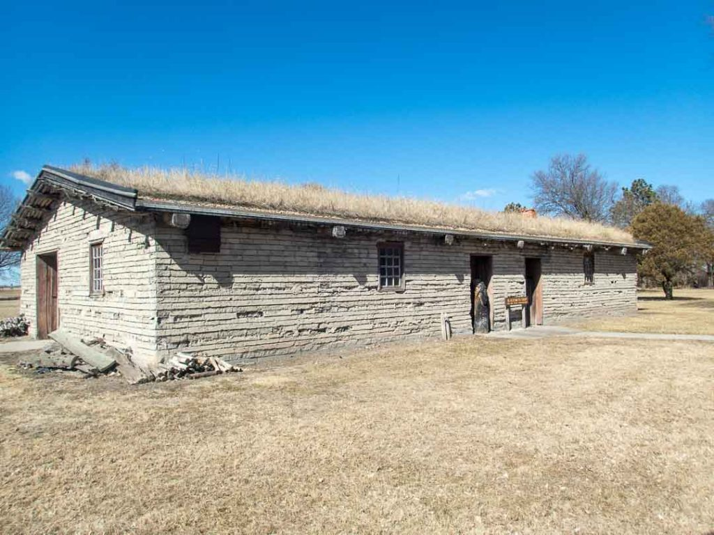 Recreated Blacksmith House - adobe style structure with grass roof - at Fort Kearny Historic Site