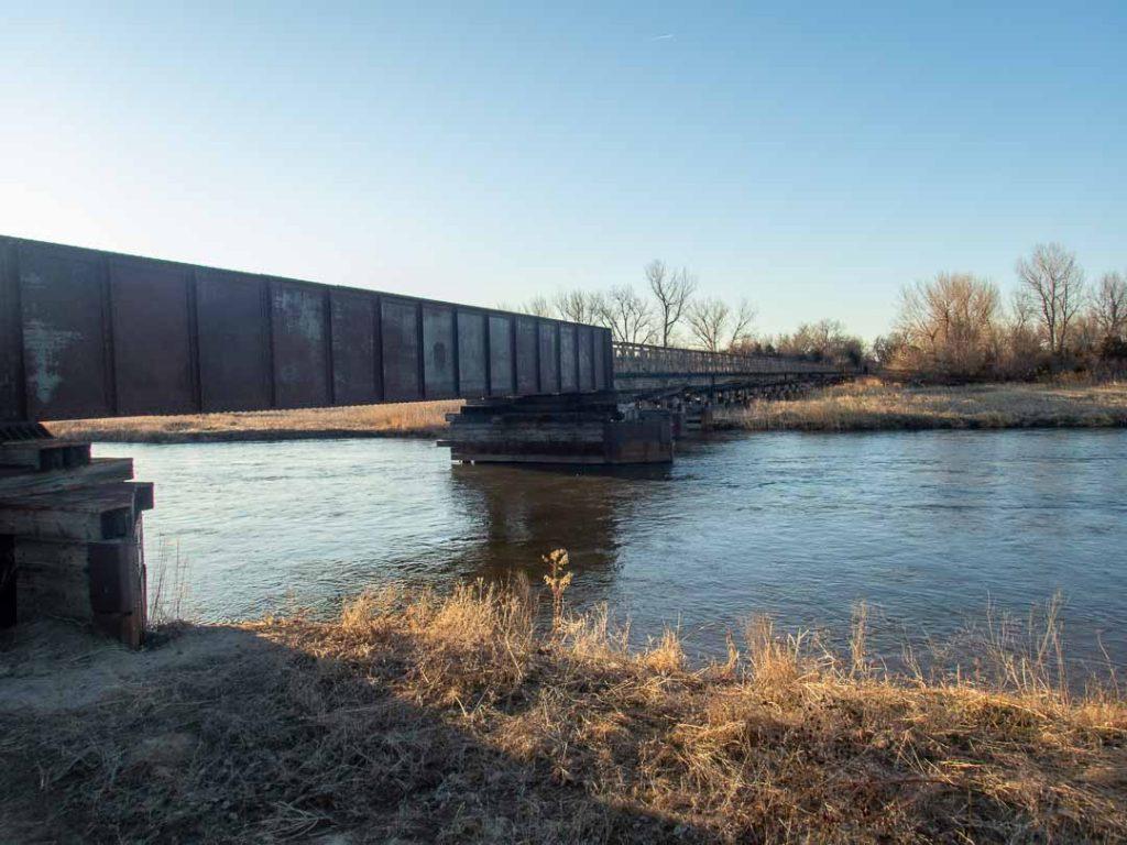 Pedestrian footbridge over shallow Platte River